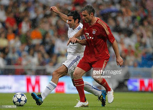 Luis Figo of Real Madrid fights for the ball with Robert Kovc of Allstars Bayern Muenchen during the Corazon Classic Match between Allstars Real...