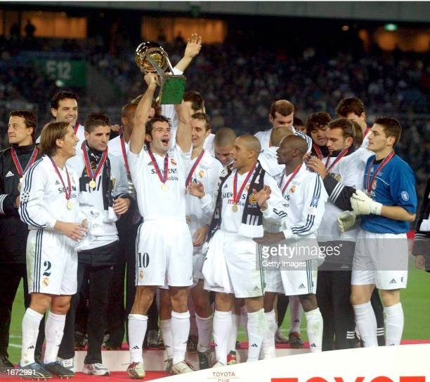 Luis Figo of Real Madrid lifts the trophy following victory in the Toyota Intercontinental Cup between Real Madrid and Olimpia played at the Yokohama...