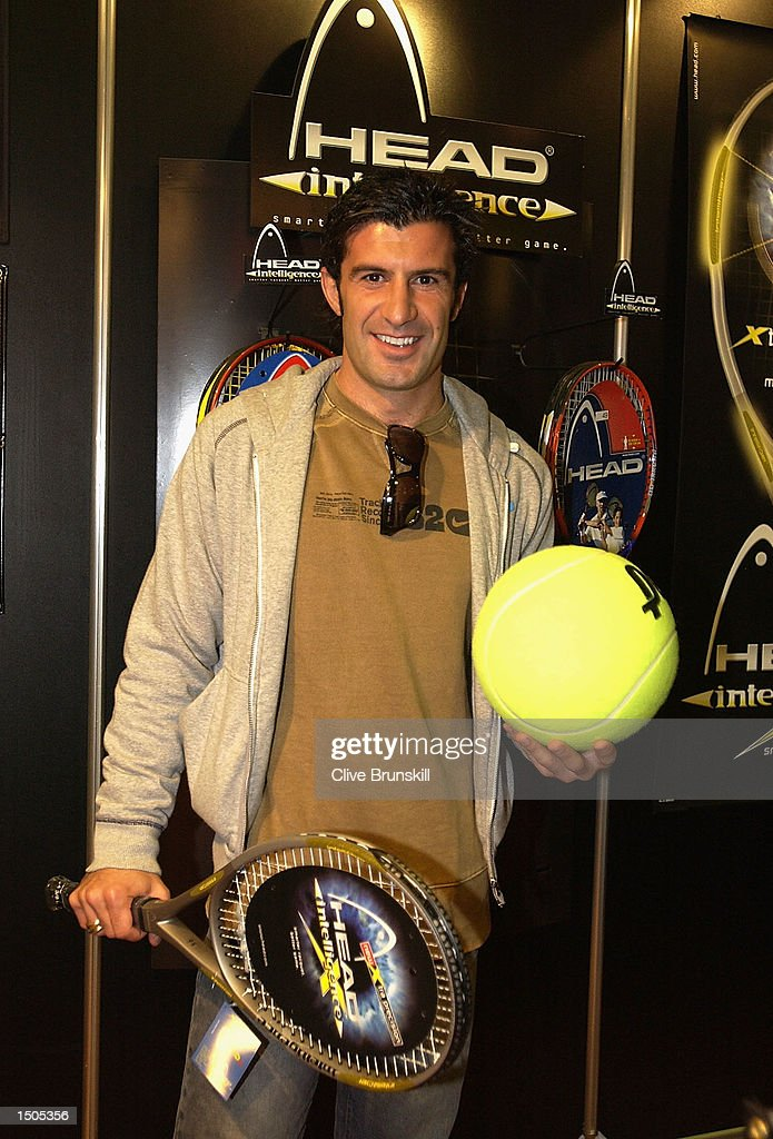 Luis Figo of Real Madrid poses for a photo at the Head Racquet stand during the Tennis Masters Madrid at The Pabellon De Cristal, Madrid, Spain on October 20, 2002.