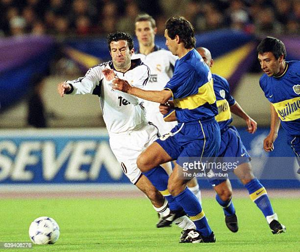 Luis Figo of Real Madrid takes on Cristian Traverso of Boca Juniors during the Toyota Cup match between Real Madrid and Boca Juniors at the National...