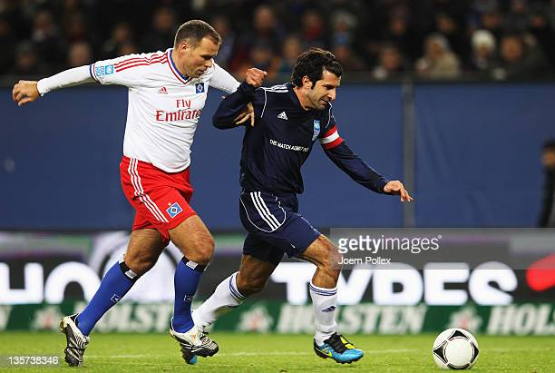Luis Figo of the team Ronaldo Zidane Friends scores his team's fifth goal during the 'Match Against Poverty' match at Imtech Arena on December 13...