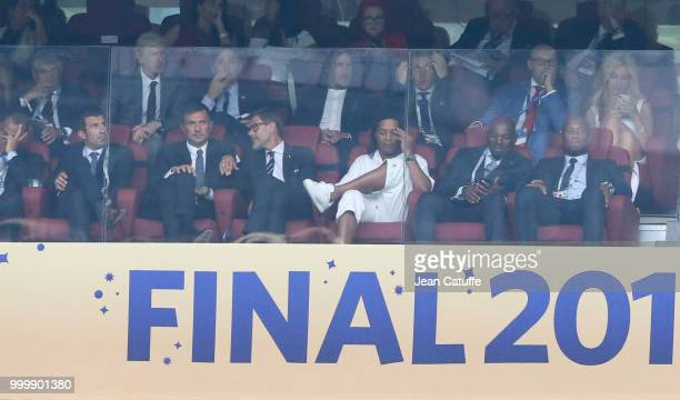 Luis Figo Paolo Maldini Ronaldinho Didier Drogba above Arsene Wenger Carles Puyol during the 2018 FIFA World Cup Russia Final match between France...