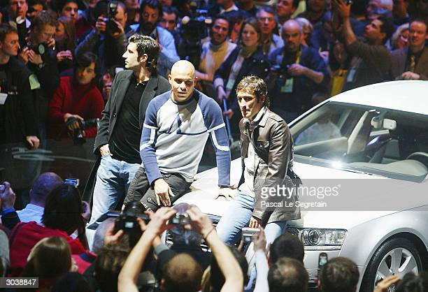 Luis Figo Ronaldo and Raul of Real Madrid pose for photographers next to the new Audi A6 car March 3 2004 at the International Motor Show in Geneva...