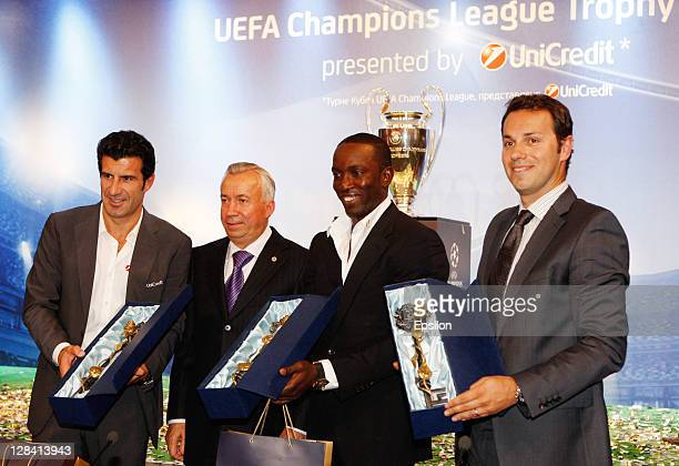 Luis Figothe Official UniCredit Ambassador for the UEFA Champions League Donetsk mayor Alexander Lukyanchenko with Dwight Yorke UEFA Champions League...