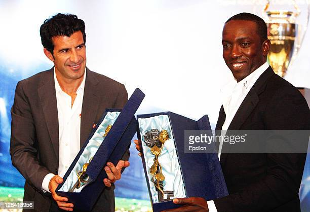 Luis Figothe Official UniCredit Ambassador for the UEFA Champions League with Dwight Yorke UEFA Champions League Trophy Tour Ambassador during the...