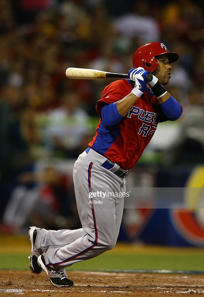 Luis Figueroa #3 of Puerto Rico drives in three runs with a double against Venezuela during the first round of the World Baseball Classic at Hiram Bithorn Stadium on March 9, 2013 in San Juan, Puerto Rico.