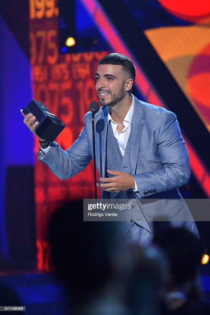 Luis Figueroa recieves award onstage at the Univision's 13th Edition Of Premios Juventud Youth Awards at Bank United Center on July 14, 2016 in Miami, Florida.