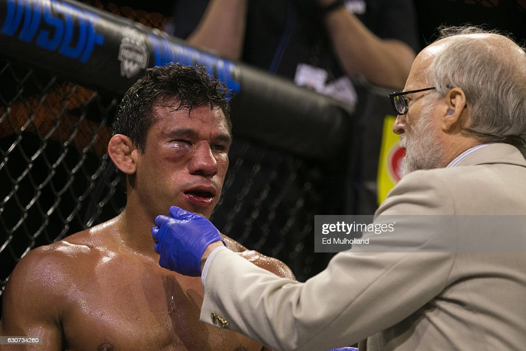 Luis Firmino is checked out by a doctor in between rounds of his World Series of Fighting lightweight championship fight at The Theater at Madison Square Garden on December 31, 2016 in New York City.