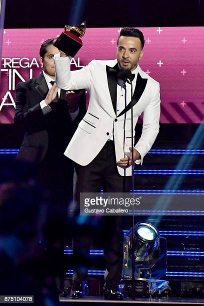 Luis Fonsi accepts the Record of the Year award for 'Despacito' onstage during The 18th Annual Latin Grammy Awards at MGM Grand Garden Arena on...