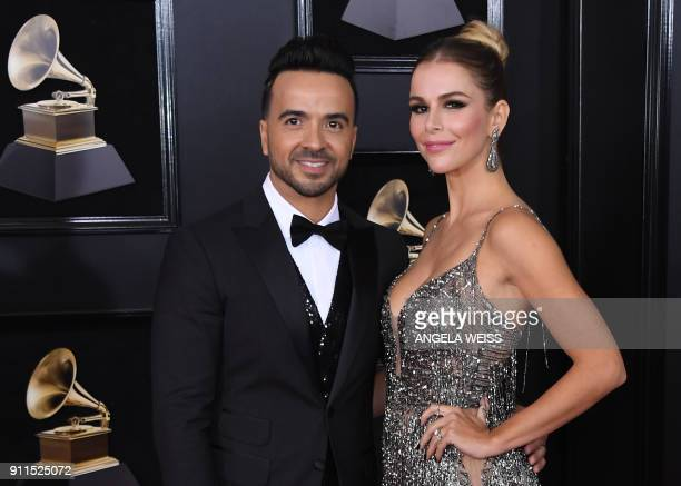 Luis Fonsi and Agueda Lopez arrive for the 60th Grammy Awards on January 28 in New York / AFP PHOTO / ANGELA WEISS
