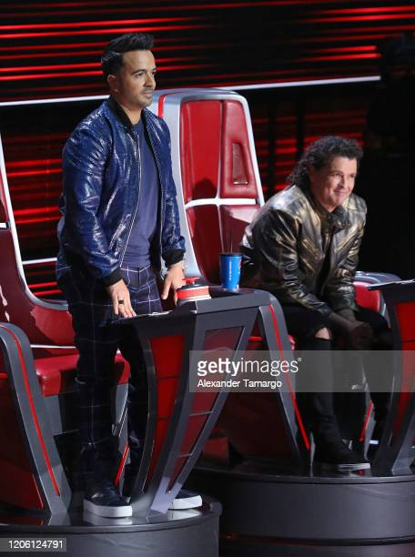 Luis Fonsi and Carlos Vives are seen on stage during Telemundo's La Voz Batallas Round 1 at Cisneros Studios on March 8 2020 in Miami Florida