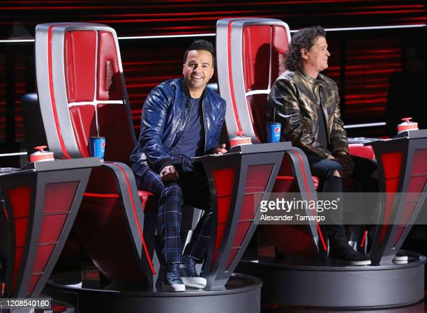 Luis Fonsi and Carlos Vives are seen on stage during Telemundo's La Voz Batallas Round 4 at Cisneros Studios on March 29 2020 in Miami Florida