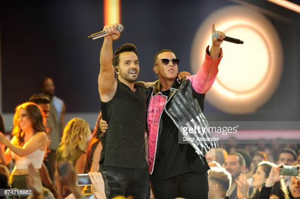 Luis Fonsi and Daddy Yankee perform onstage at the Billboard Latin Music Awards at Watsco Center on April 27 2017 in Coral Gables Florida