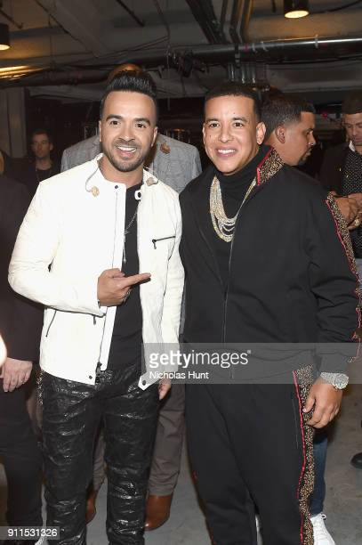 Luis Fonsi and Daddy Yankee pose backstage at the 60th Annual GRAMMY Awards at Madison Square Garden on January 28 2018 in New York City