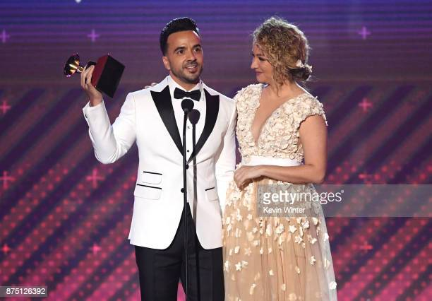 Luis Fonsi and Erika Ender accept Song of the Year for 'Despacito' onstage at the 18th Annual Latin Grammy Awards at MGM Grand Garden Arena on...