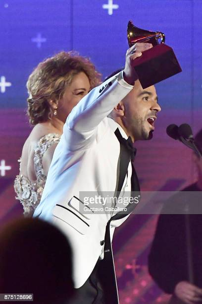 Luis Fonsi and Erika Ender accept the Song of the Year award for 'Despacito' onstage during The 18th Annual Latin Grammy Awards at MGM Grand Garden...
