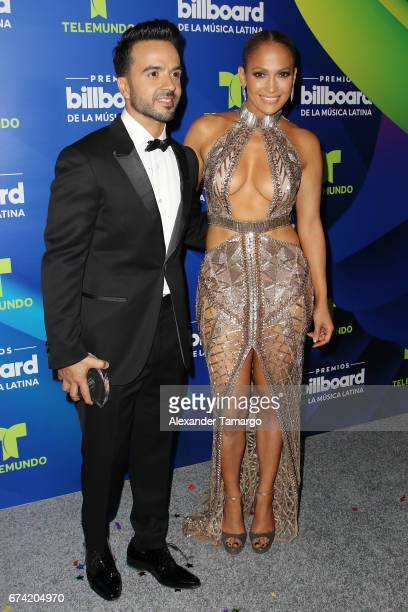 Luis Fonsi and Jennifer Lopez pose in the press room during the Billboard Latin Music Awards at Watsco Center on April 27 2017 in Coral Gables Florida
