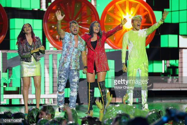 Luis Fonsi and Los Polinesios get slimed on stage during the Nickelodeon Kids' Choice Awards Mexico 2018 at Auditorio Nacional on August 19 2018 in...