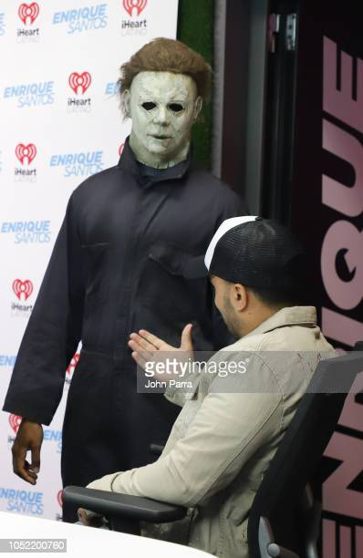 Luis Fonsi meets Michael Myers at The Enrique Santos Show At I Heart Latino Studios on October 15 2018 in Miramar Florida