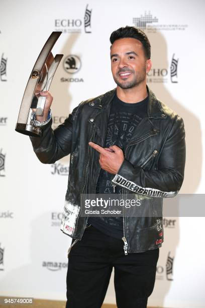 Luis Fonsi poses with award during the Echo Award winners board at Messe Berlin on April 12 2018 in Berlin Germany