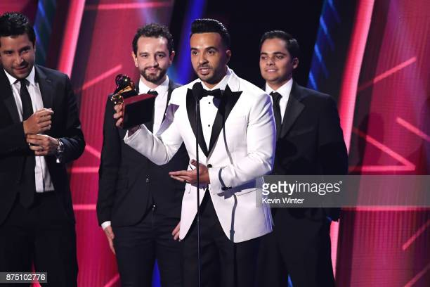 Luis Fonsi with producers Mauricio Rengifo Andres Torres and Luis Saldarriaga accept Record of the Year for 'Despacito' onstage at the 18th Annual...