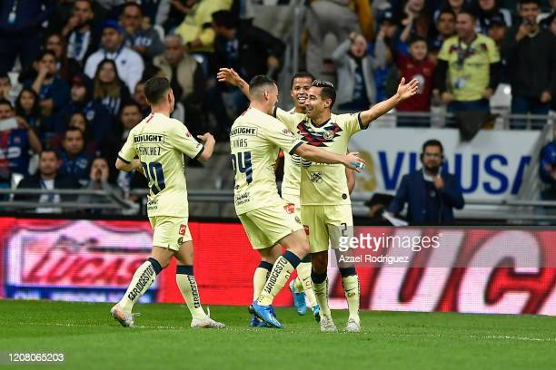 Luis Fuentes of América celebrates with teammates after scoring his team's first goal during the 7th round match between Monterrey and America as...