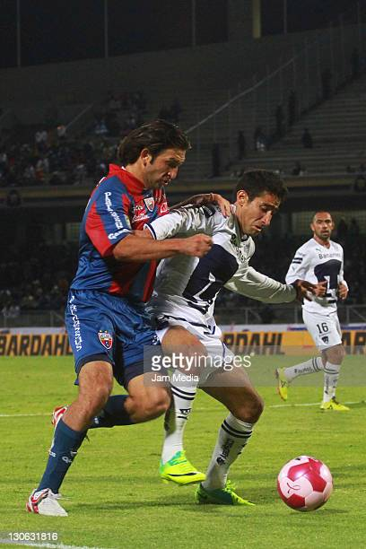 Luis Fuentes of Pumas struggles for the ball with Francisco Fonseca of Atlante during a match as part of the Apertura 2011 at Olympic Stadium on...