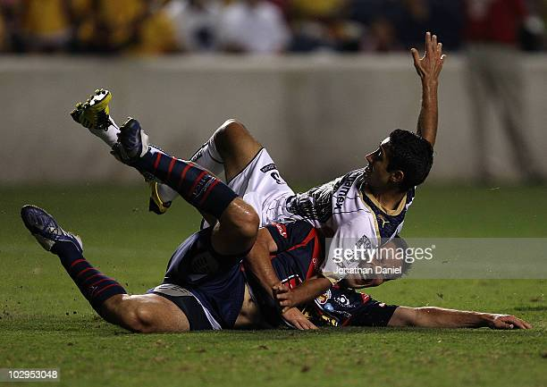 Luis Fuentes of Pumas UNAM lands on Luis Gabriel Rey of Monarcas Morelia after Rey fied a shot on goal during a SuperLiga 2010 match at Toyota Park...