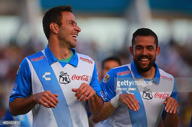 Luis Gabriel Rey of Puebla celebrates with Herculez Gomez after scoring the first goal of his team during a match between Puebla and Monterrey as...
