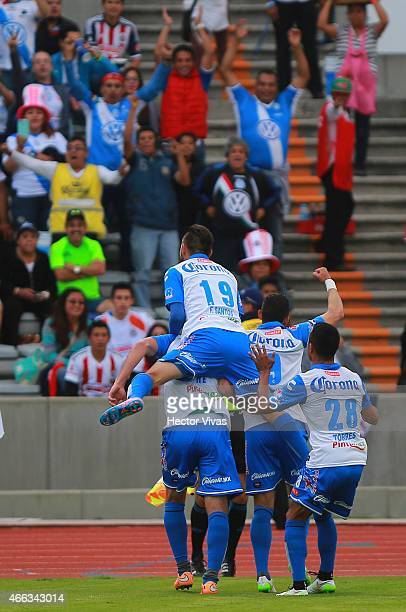 Luis Gabriel Rey of Puebla celebrates with teammates after scoring the first goal of his team during a match between Puebla and Chivas as part of...