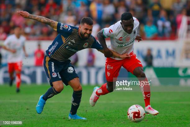 Luis Gallegos of San Luis fights for the ball with Kevin Mercado of Necaxa during the 3rd round match between Necaxa and Atletico San Luis as part of...