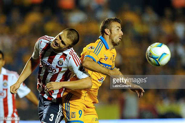 Luis García of Tigres and Kristian Álvarez of Chivas figth for the ball during the match between Tigres and Chivas as part of the Clausura 2013 Liga...