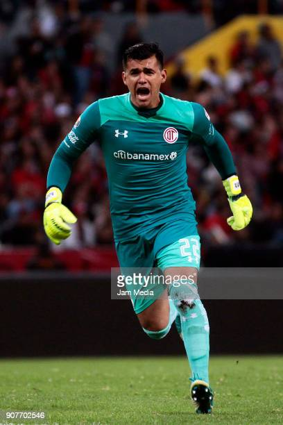 Luis Garcia goalkeeper of Toluca celebrates the first goal scored by teammate Alexis Canelo during the third round match between Atlas and Toluca as...