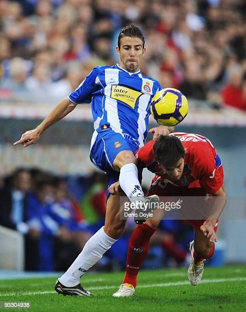 Luis Garcia of Espanyol clashes with Adrian Gonzalez of Getafe during the La Liga match between Espanyol and Getafe at CornellaEl Prat stadium on...