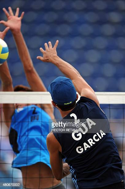 Luis Garcia of Guatemala hits the ball atball with Uruguay's Mauricio Vieyto during their men's Beach Volleyball Preliminary Uruguay vs Guatemala at...