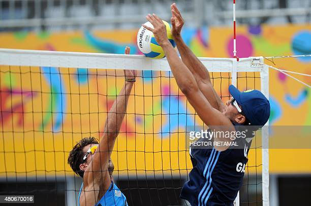 Luis Garcia of Guatemala tries to block during the men's Beach Volleyball Preliminary match against Uruguay at the 2015 Pan American Games in Toronto...