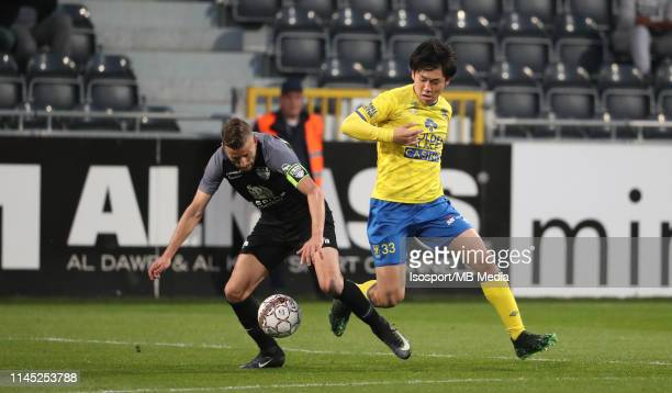 Luis Garcia of Kas Eupen and Wataru Endo of STVV fight for the ball during the Jupiler Pro League playoff 2 group A match between Kas Eupen and Stvv...