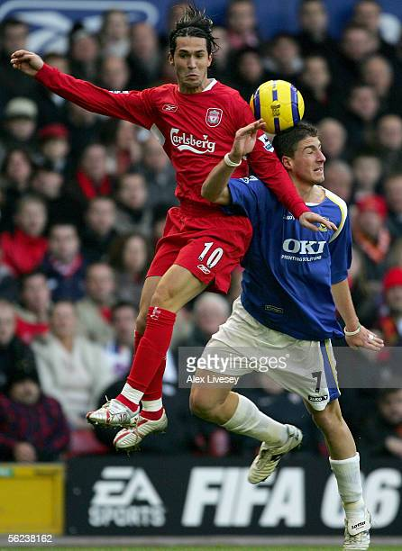 Luis Garcia of Liverpool battles for the ball with Gregory Vignal of Portsmouth during the Barclays Premiership match between Liverpool and...