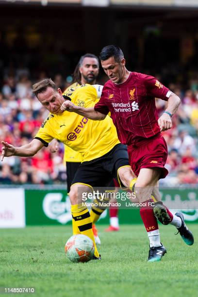 Luis Garcia of Liverpool FC attempts a kick while being defended by Jorg Heinrich of Borussia Dortmund during the match between Liverpool FC Legend...