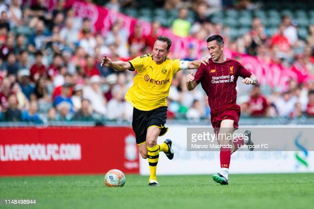 Luis Garcia of Liverpool FC fights for the ball with Jorg Heinrich of Borussia Dortmund during the match between Liverpool Legend and Borussia...