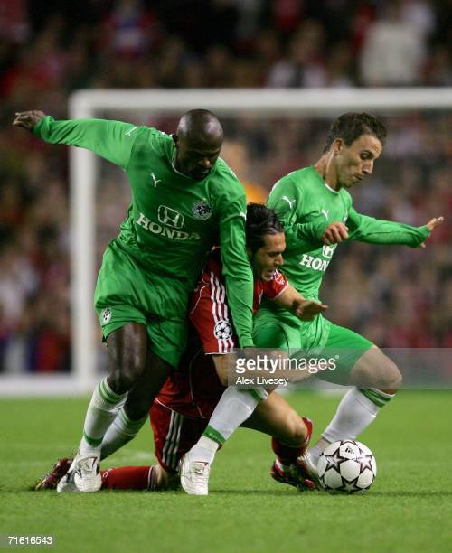 Luis Garcia of Liverpool is sandwiched by Xavir Dirceo and Gustavo Boccoli of Maccabi Haifa during the UEFA Champions League third qualifying round...