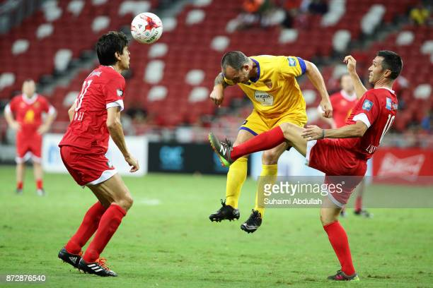 Luis Garcia of Liverpool Masters challenges David Hillier of Arsenal Masters as Jari Litmanen of Liverpool Masters looks on during the Battle of the...