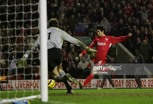 Luis Garcia of Liverpool shoots past Jens Lehmann of Arsenal to score the winning goal during the Barclays Premiership match between Liverpool and...