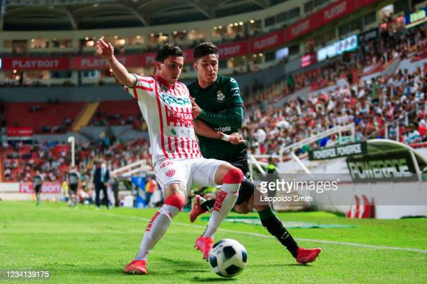 Luis Garcia of Necaxa struggles for the ball with Omar Campos of Santos Laguna during the 1st round match between Necaxa v Santos Laguna as part of...