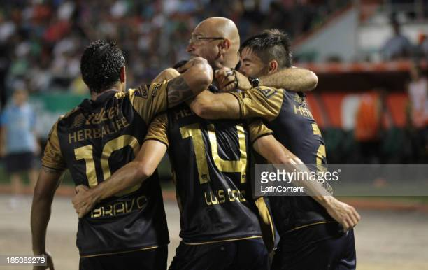 Luis Garcia of Pumas celebrates a scored goal with teammates during a match between Chiapas and Pumas de la UNAM as part of the Apertura 2013 Liga MX...