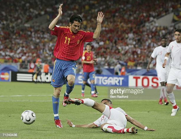Luis Garcia of Spain is tackled by Anis Ayari of Tunisia during the FIFA World Cup Germany 2006 Group H match between Spain and Tunisia at the...