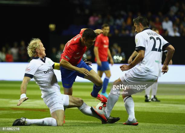 Luis Garcia of Spain is tackled by Colin Hendry of Scotland during the Star Sixe's match between Spain and Scotland at The O2 Arena on July 15 2017...