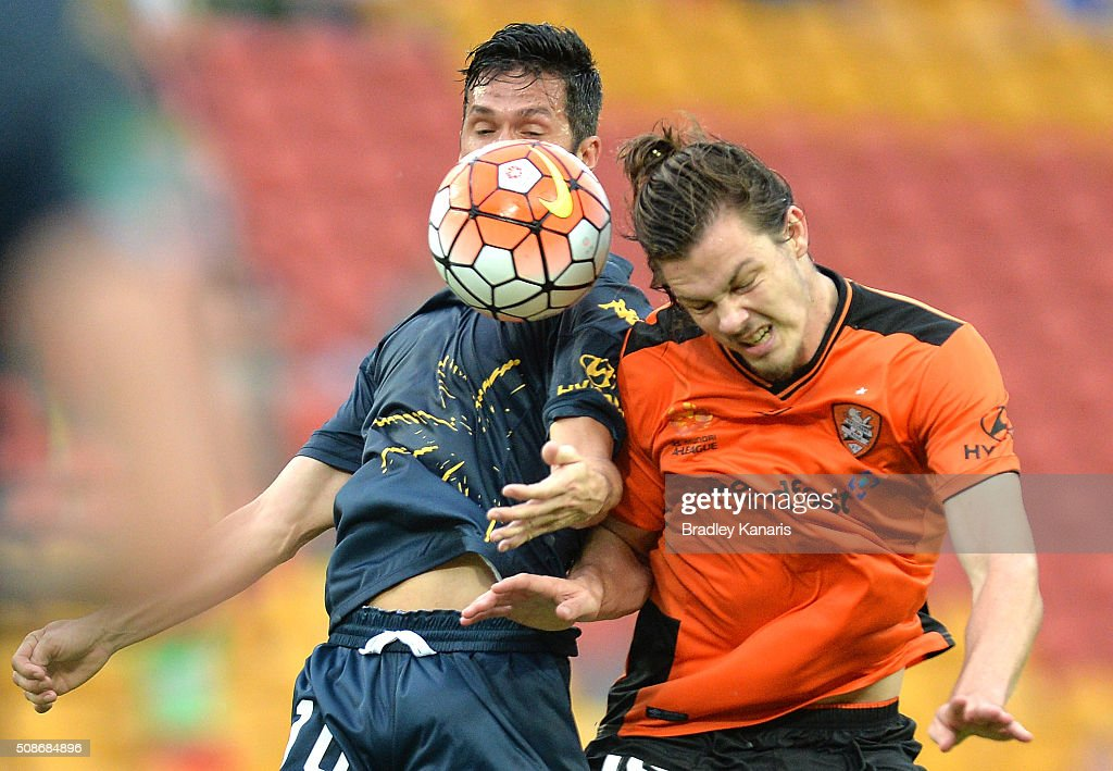Luis Garcia of the Mariners and James Donachie of the Roar challenge for the ball during the round 18 A-League match between the Brisbane Roar and Central Coast Mariners at Suncorp Stadium on February 6, 2016 in Brisbane, Australia.