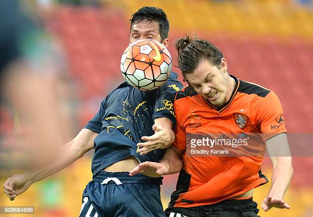 Luis Garcia of the Mariners and James Donachie of the Roar challenge for the ball during the round 18 ALeague match between the Brisbane Roar and...
