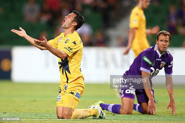 Luis Garcia of the Mariners appeals to Referee Adam Fielding after being issued his second yellow card for a tackle on Krisztian Vadocz of the Glory...